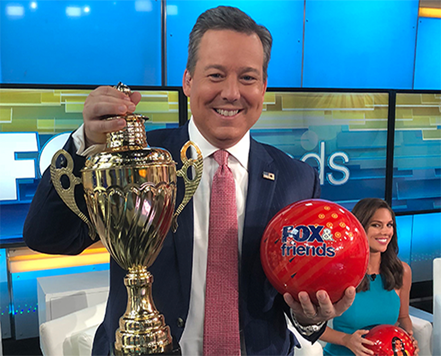 Host with Ball and Trophy